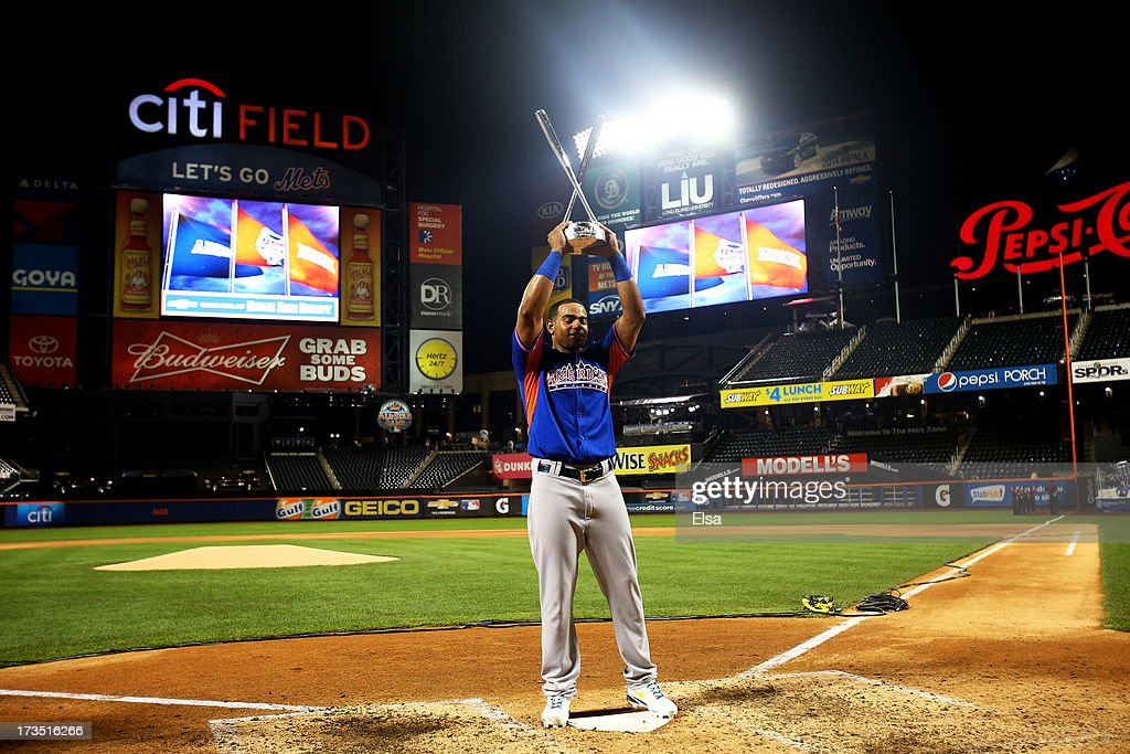 Yoenis Cespedes of the Oakland Athletics poses with the trophy after winning Chevrolet Home Run Derby on July 15, 2013 at Citi Field in the Flushing neighborhood of the Queens borough of New York City.