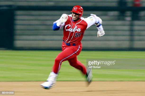 Yoennis Cespedes of Cuba runs to third base after hitting into the corner of the outfield againts Japan during the 2009 World Baseball Classic Round...
