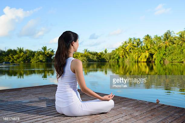 yoga and lotus position - place of worship stock pictures, royalty-free photos & images