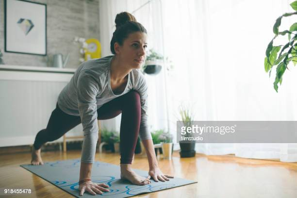yoga at home - exercising stock pictures, royalty-free photos & images