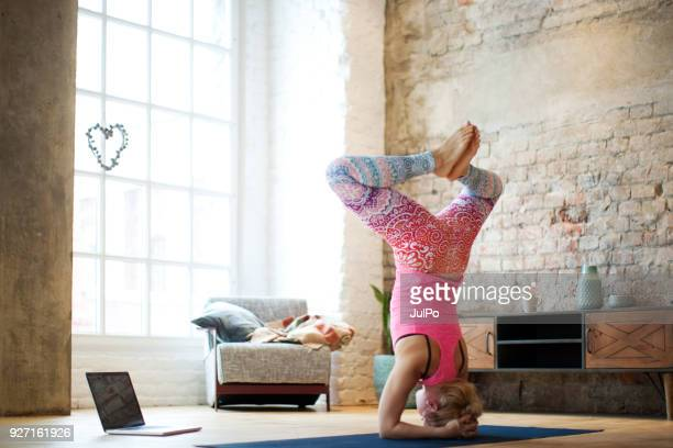 yoga at home with laptop - handstand stock pictures, royalty-free photos & images