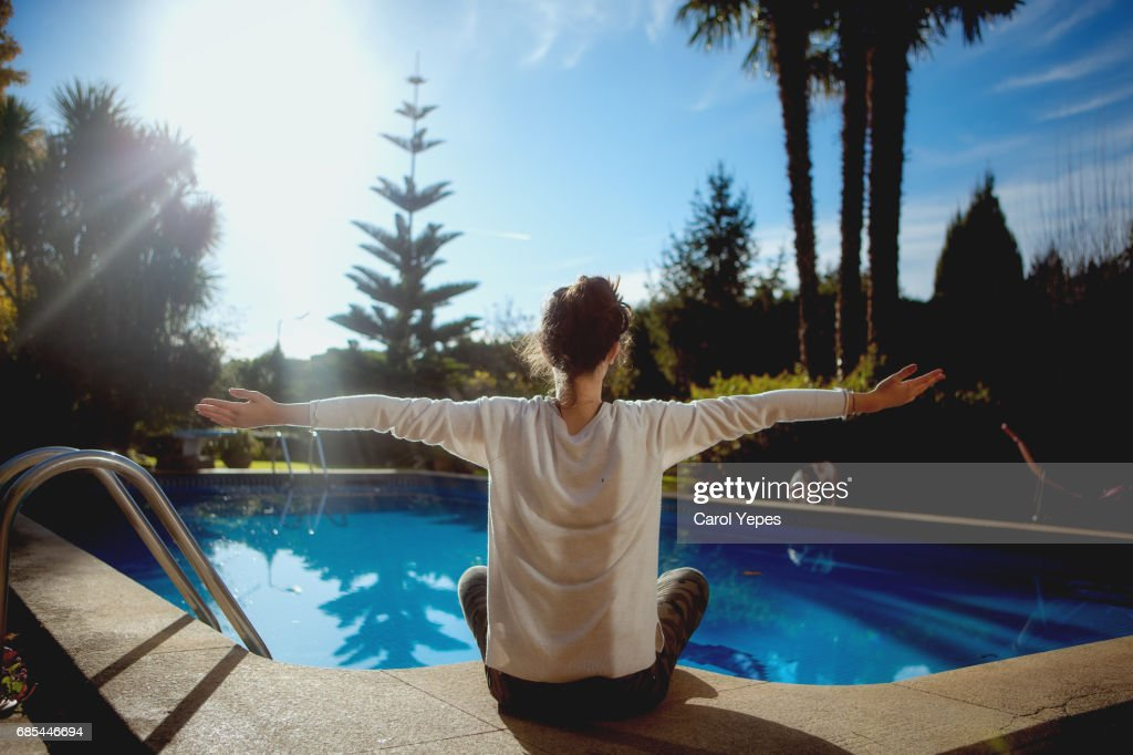 yoga at the poolside. : Stock Photo