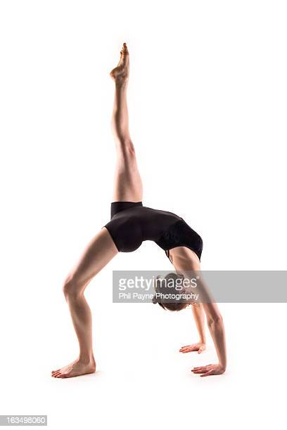 yoga back bend with one leg raised - bending over backwards stock photos and pictures