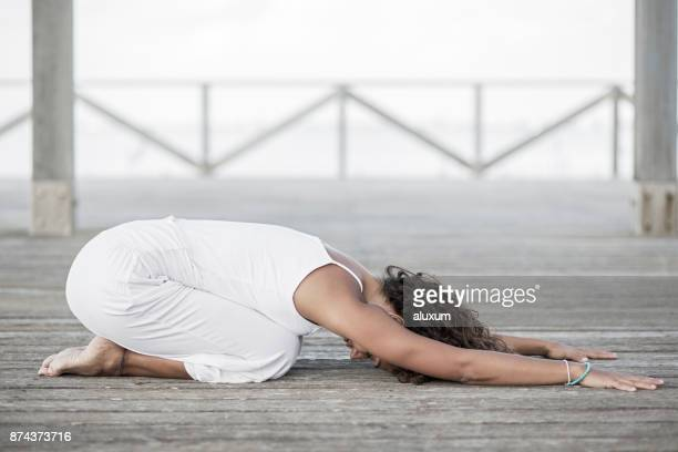 yoga balasana child pose - childs pose stock photos and pictures
