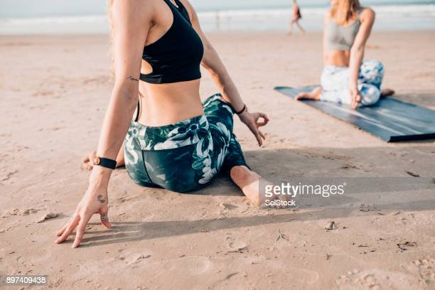 yoga by the sea - yoga pants stock photos and pictures