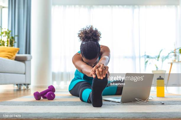 yoga can always be modified to fit people's needs - home workout stock pictures, royalty-free photos & images