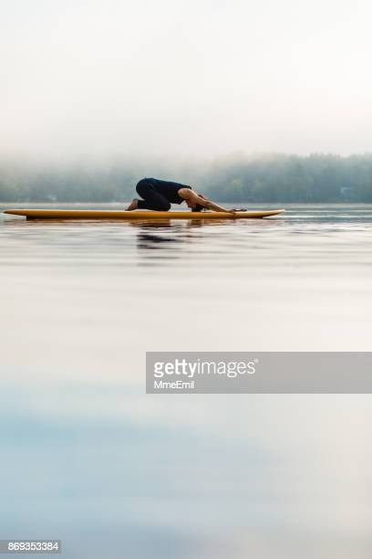 sup yoga - child's pose - balasana - childs pose stock photos and pictures