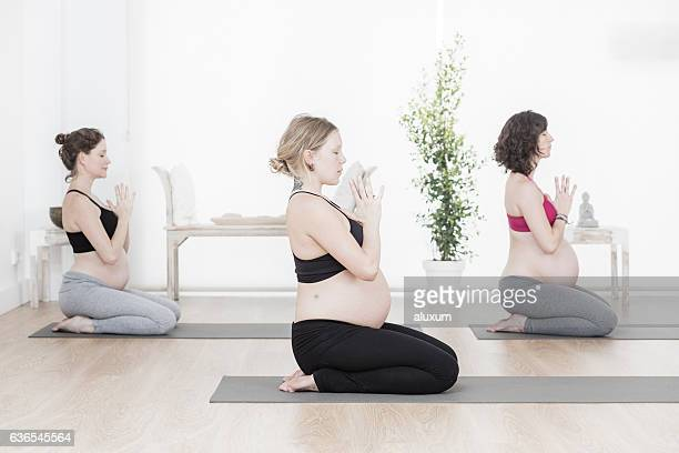 yoga class for pregnant woman - physical description stock pictures, royalty-free photos & images