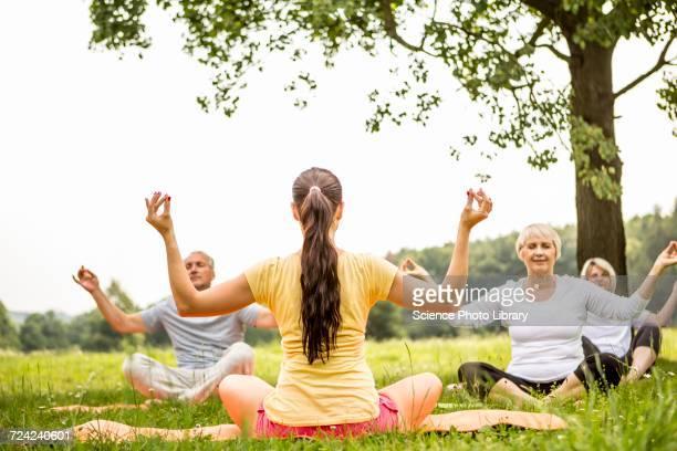 Yoga class in field