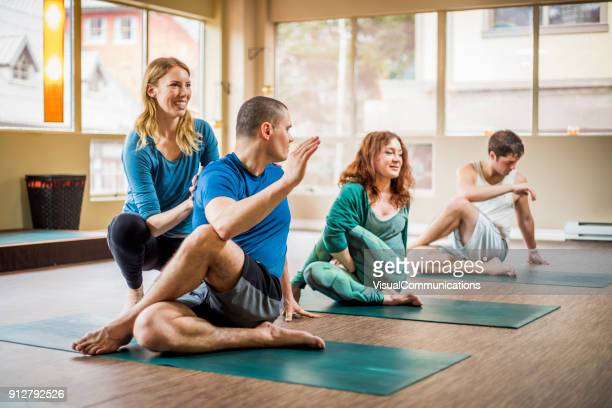 yoga class in studio. - yoga teacher stock pictures, royalty-free photos & images