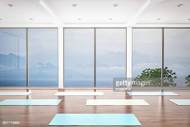 yoga class interior - mat stock pictures, royalty-free photos & images