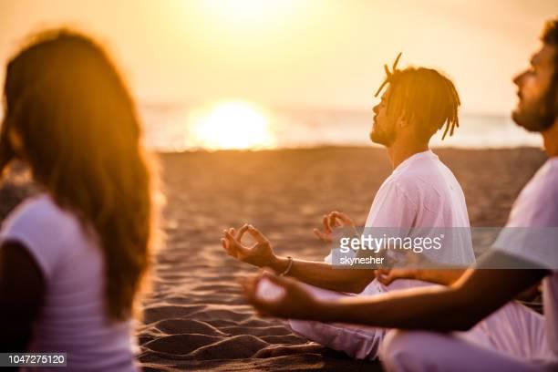 Yoga class on the beach at sunset!