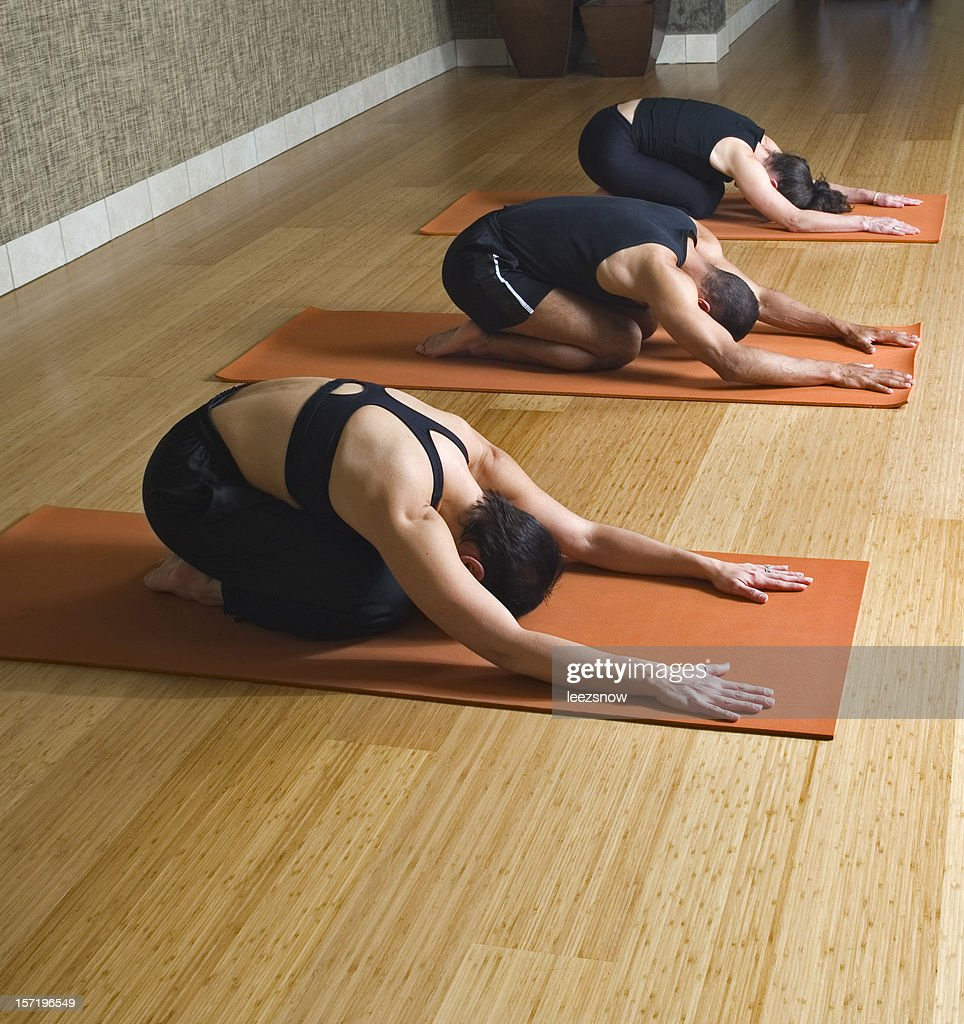 yoga class with three people in childs pose stock photo getty images