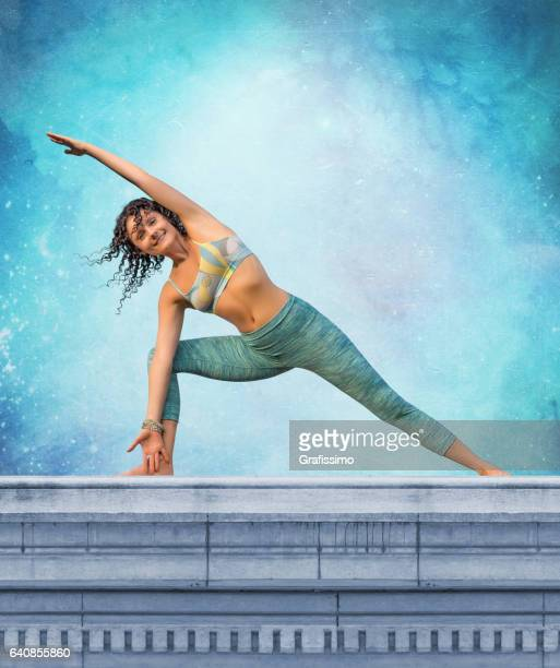 Yoga concept woman posing exercises outdoors on balustrade
