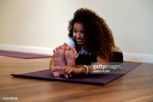 Yoga enthusiast Yasmin Machri practices at a studio in the western Saudi Arabian city of Jeddah on September 7 2018 Widely perceived as a Hindu...