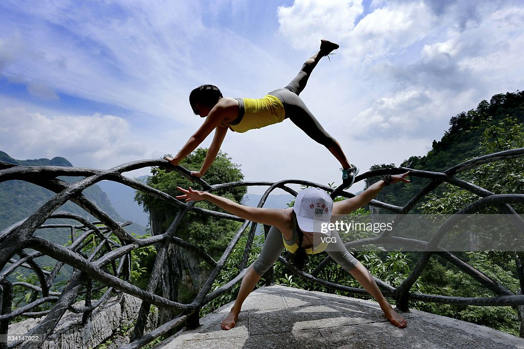 Yoga Enthusiasts Perform On Glass Plank Road : News Photo
