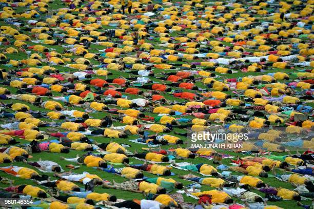 TOPSHOT Yoga enthusiasts perform yoga to mark International Yoga Day at the Sri Kanteerava Stadium in Bangalore on June 21 2018 Downwardfacing dogs...