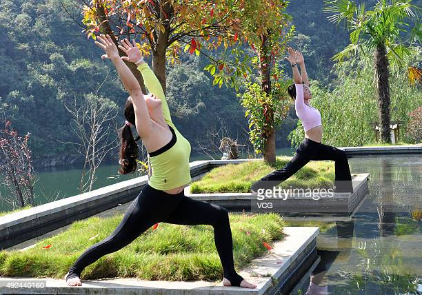 Yoga enthusiasts practice in front of a mountain on October 11 2015 in Wuyuan County Shangrao City Jiangxi Province of China