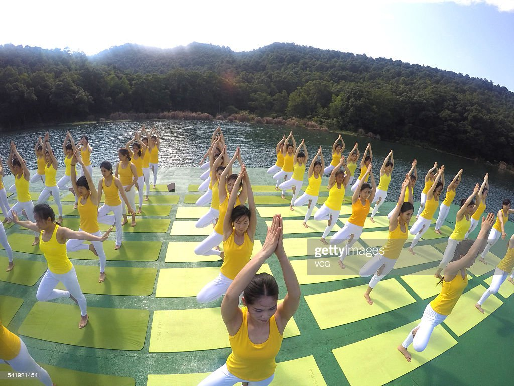 Practicing Yoga Above Water In Changsha : News Photo