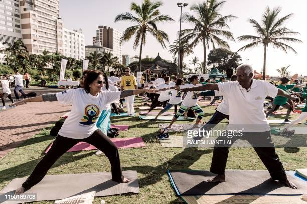 Yoga enthusiasts take part in a mass yoga session at the amphitheatre lawns at North Beach on June 16 2019 in Durban South Africa ahead of the...