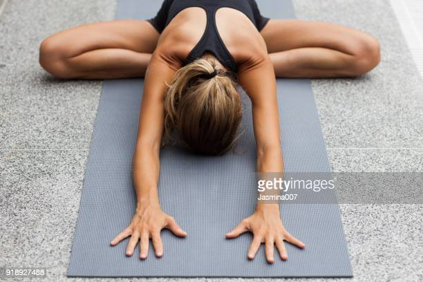 yoga exercises at home - childs pose stock photos and pictures