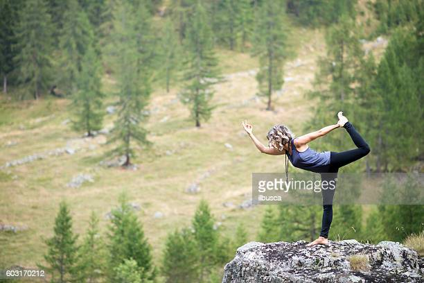Yoga exercises in nature: Dancer pose