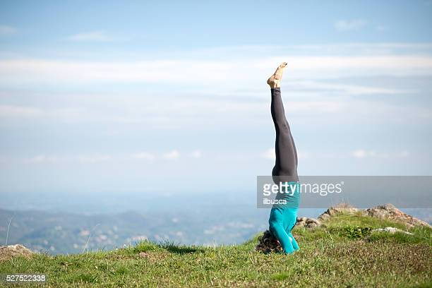 yoga exercises in nature on mountains: headstand - yoga pants stock photos and pictures