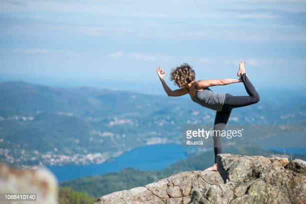 Yoga exercises in nature on mountains: Natarajasana