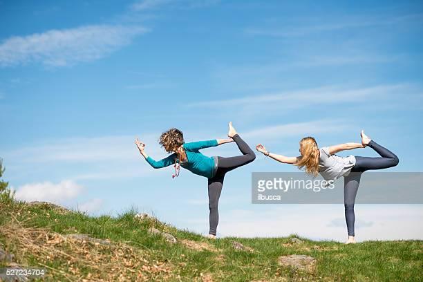 Yoga exercises in nature on mountains: Natarajasana