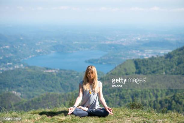 Yoga exercises in nature on mountains: Padmasana