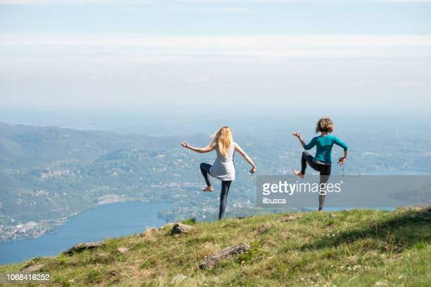 Yoga exercises in nature on mountains: Shiva dance pose