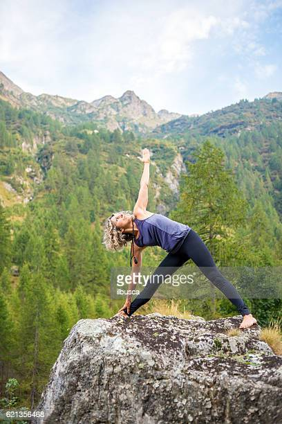 Yoga exercises in nature: Triangle pose