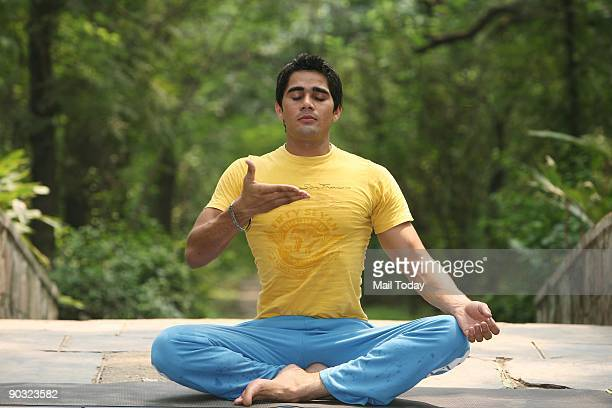 Yoga expert and instructor Dinesh Dagar showing Pranayama Pooraka or Inhalation to remove pollution from the lungs on September 1 2009