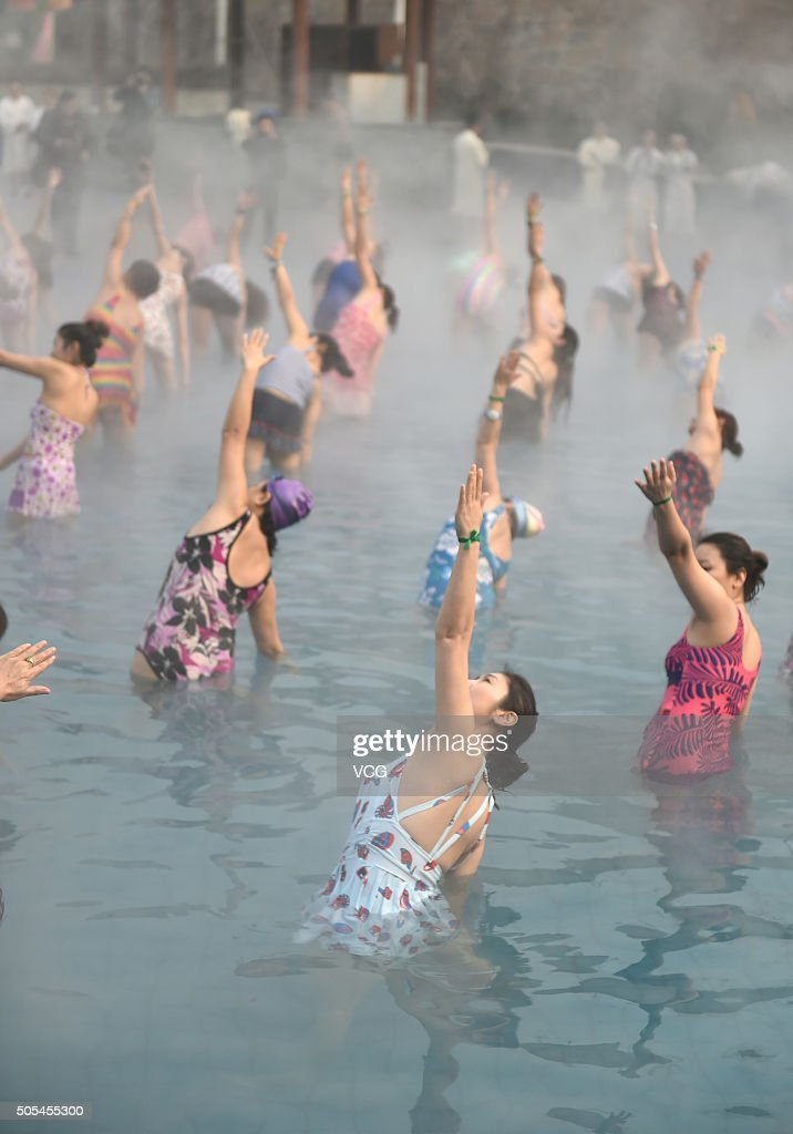 Yoga fans practice in a hot spring on January 17, 2016 in Luoyang, Henan Province of China. Nearly a hundred yoga fans performed yoga in a hot spring as the temperature dropped to 4 degrees Celsius below zero on January 17 in Luoyang.
