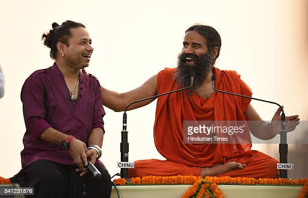 Yoga Guru Baba Ramdev and singer Kailash Kher during the rehearsals for the upcoming International Yoga Day at Rajpath on June 19 2016 in New Delhi...