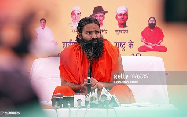 Yoga guru Baba Ramdev coming out of a press conference on March 21 2014 in New Delhi India Ramdev will launch a 'Yoga Mahotsav' across India with...