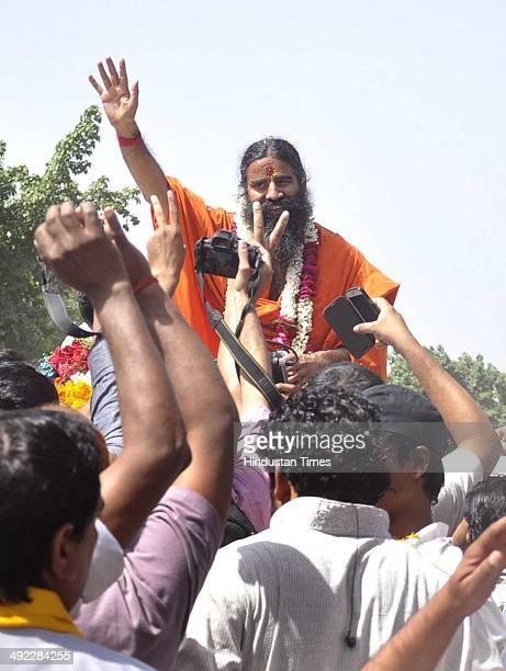 Yoga guru Baba Ramdev conducted a roadshow from Delhi to Haridwar after massive victory by Bharatiya Janata Party in Lok Sabha polls 2014 on May 19...