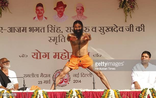 Yoga guru Baba Ramdev during a 'Yoga Mahotsav' at Ramlila Maidan on March 23 2014 in New Delhi India Modi accused the Congress of creating problems...