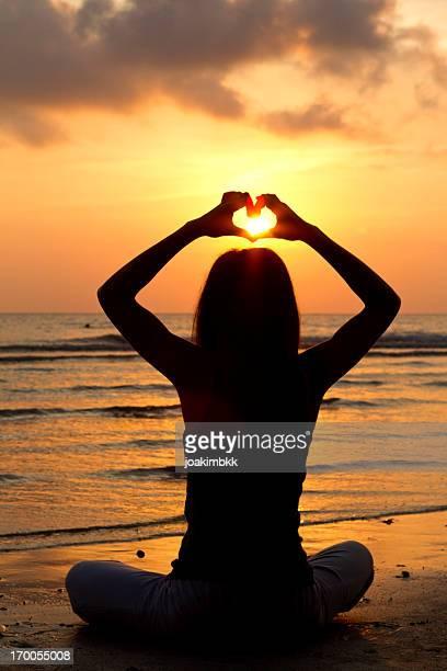 Yoga heart by the beach
