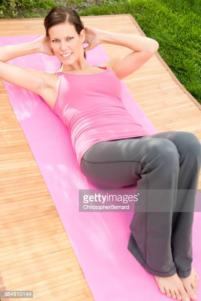 yoga in backyard - yoga pants stock photos and pictures