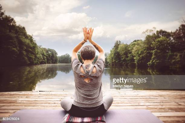 yoga in front of a body of water - piedmont park atlanta georgia stock pictures, royalty-free photos & images