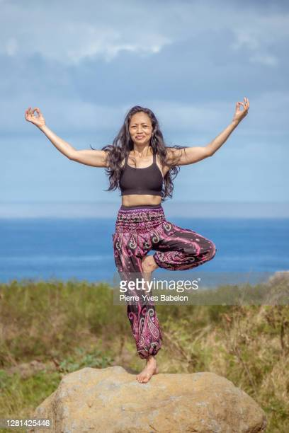 yoga in front of the sea - pierre yves babelon stock pictures, royalty-free photos & images