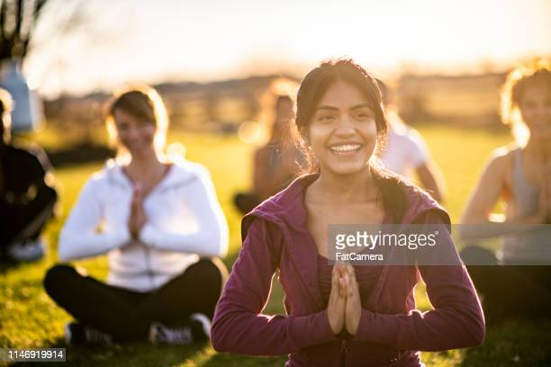 yoga in the park - zen like stock pictures, royalty-free photos & images