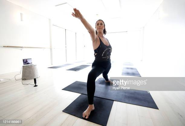 Yoga instructor Asha Elliott conducts a live stream Yoga class at the Clovelly 'This is Yoga' studio on March 23 2020 in Sydney Australia From midday...