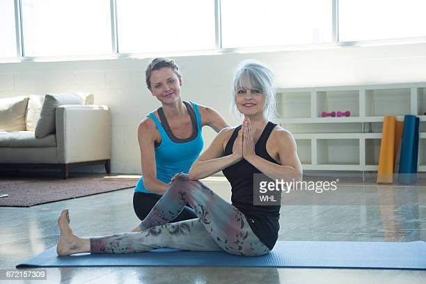 yoga instructor assisting student - foot worship stock pictures, royalty-free photos & images