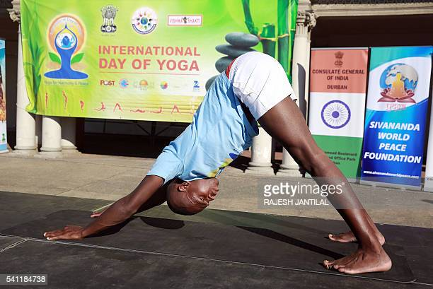 A yoga instructor demonstrates a position known as downward dog as hundreds of people take part in a yoga session as part of the International Day of...