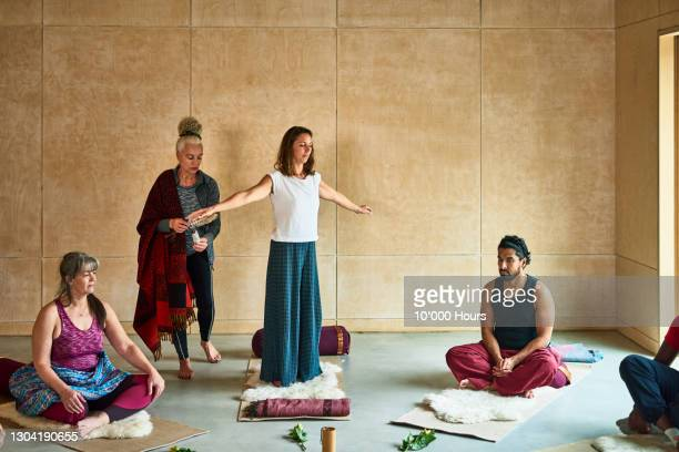 yoga instructor demonstrating using smudge stick in class - limb body part stock pictures, royalty-free photos & images