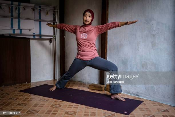 Yoga instructor Dewi Amsari teaching an online class from her home as the government closed tourist destinations schools offices and urging citizens...