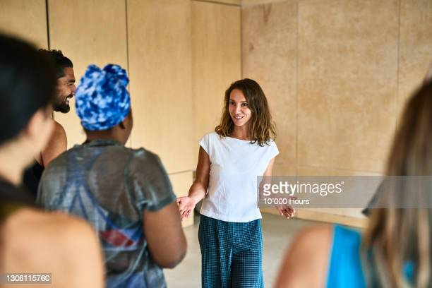 yoga instructor discussing with class - speech stock pictures, royalty-free photos & images