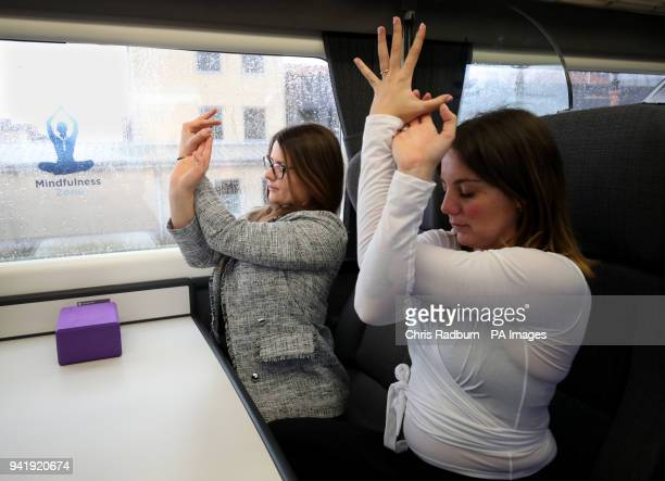 Yoga instructor Ellie Di Martino and passengers take part in a yoga session during the launch of the Chiltern Railways Mindfulness Zone at Birmingham...